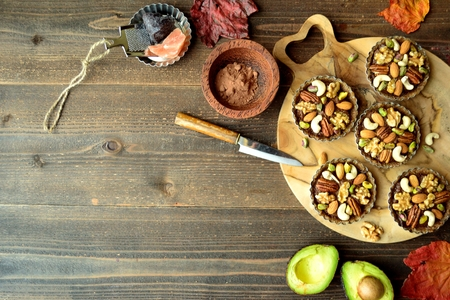 Nuts tarts on the wooden cutting board