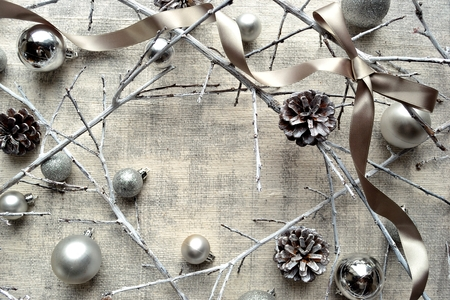 Silver Christmas ornament balls, twigs and ribbon.frame