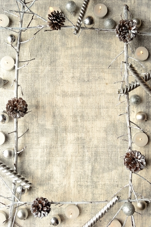 Silver Christmas ornaments with candles.frame