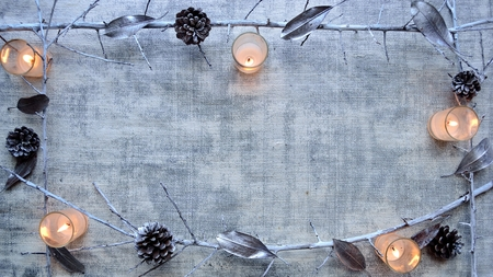 Silver fallen leaves, pine cones, dead branch and candles.frame Stock fotó