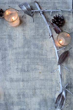 Silver fallen leaves, pine cones, dead branch and candles.frame Reklamní fotografie