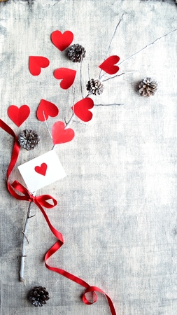 cone shaped: Red heart shaped paper cut out, pine cones and the message card