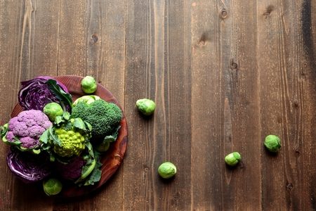 romanesco: Purple cauliflower and broccoli served on a wooden dish