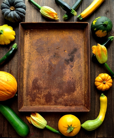Zucchini, pumpkins and rusted tray.frame Stock Photo