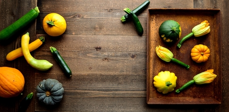 Flower of zucchini with pumpkin on the rusted tray Stock Photo