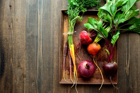 Colorful beets and carrots on the rusted tray Stock Photo