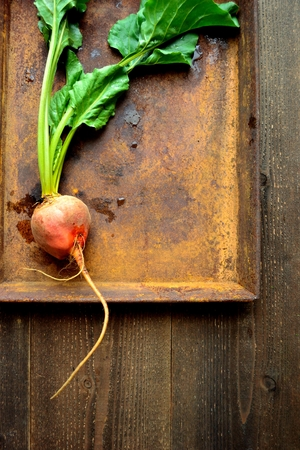 Orange beet on the rusted tray