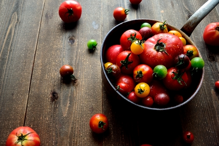 colorful tomatoes on the saucepan
