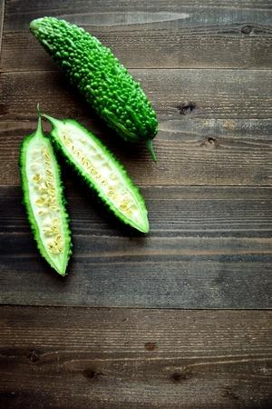 Bitter gourds om the wooden background Reklamní fotografie