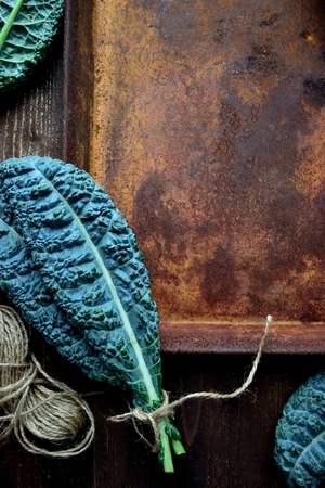 Kale leaves with rusted tray Stock Photo