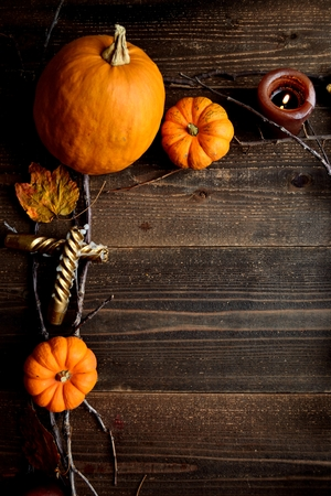 Pumpkins, candles and autumn leaves.frame