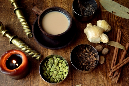 Chai tea and spices on the wooden background