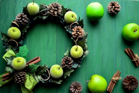 Green apple Christmas wreath on the green background Stock fotó