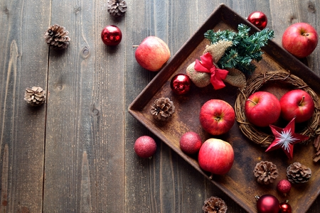 Red apples and Christmas decorations on the rusted tray Stock Photo - 90613928