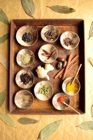 Indian food ingredients on the rusted tray Imagens