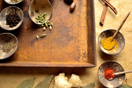 Spices, Indian food ingredients and rusted tray
