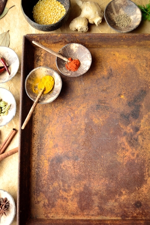 Indian food ingredients with rusted tray Imagens