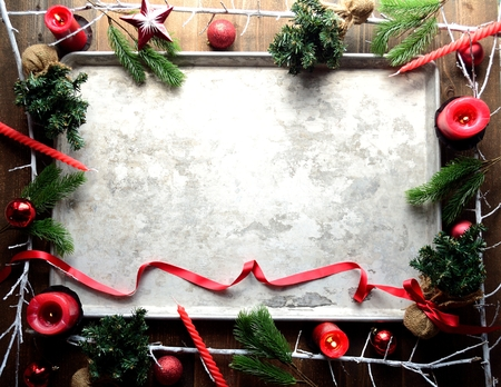 Red Christmas ornaments and silver tray Stock Photo