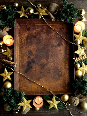 Gold star shaped Christmas ornaments and rusted tray