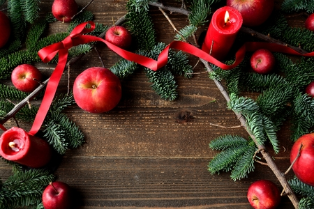 Apples, fir leaves with red ribbon.frame. Stock Photo - 91519026