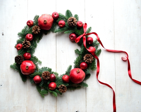 Pomegranate, apples and fir leaves. Christmas wreath Stok Fotoğraf