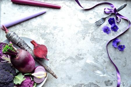 Purple vegetables, candles and fork Banco de Imagens