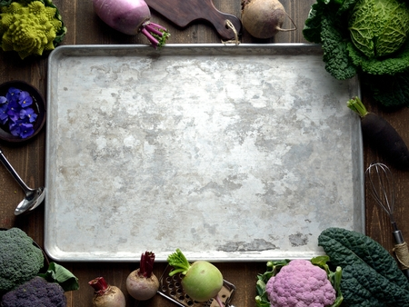 Purple and green vegetables with silver tray