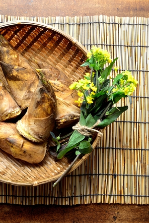 Bamboo shoots with blossoms on the basket. Japanese style blind