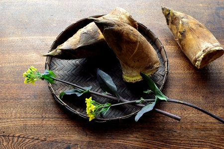 Bamboo shoots with rape blossoms on the black basket