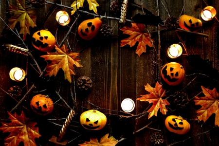 Halloween pumpkin, autumn leaves and candle light