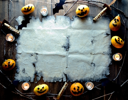 Halloween pumpkin with old tattered paper 스톡 콘텐츠 - 107382905