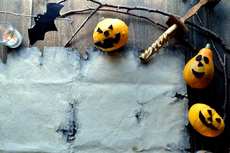Halloween pumpkin with old tattered paper Stock Photo