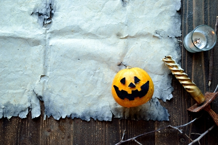 Halloween pumpkin with old tattered paper 版權商用圖片