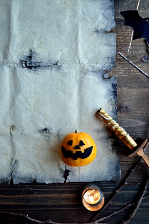 Halloween pumpkin with old tattered paper 스톡 콘텐츠 - 107382914