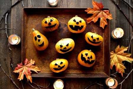 Halloween pumpkins with rusted tray Stock Photo