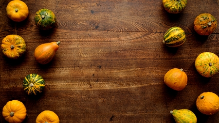 Colorful pumpkins on the wooden background Stock Photo - 112697367
