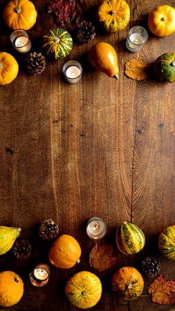 Colorful pumpkins, autumn leaves and candles