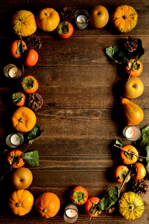 Pumpkins, persimmons and candles 스톡 콘텐츠