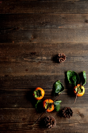 Persimmons with pine cones