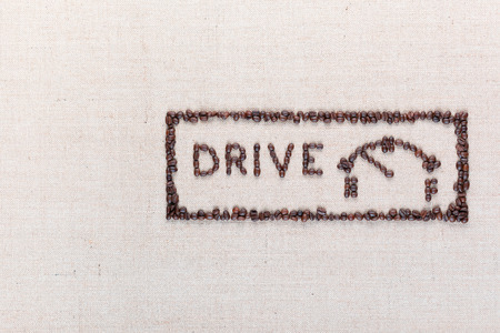 Word drive next to a fuel gauge inside a rectangle all made up from coffee beans, aligned on the right.