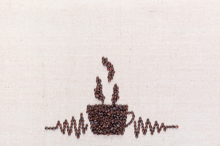 Just prepared hot coffee crafted using coffee beans, aligned in the center at the bottom.
