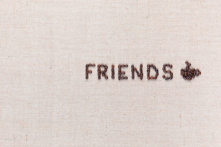 The word friends next to a hot coffee mug all made up from coffee beans ,aligned to the right.