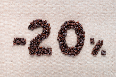 Roasted coffee beans shaping 20% off writing on creamy linen background, aligned in center, shot close up