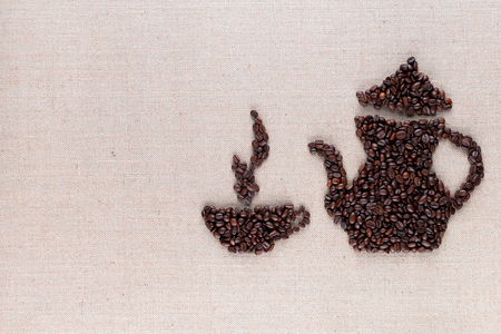 Roasted coffee beans forming steamy cup and pot on linen surface, aligned middle right