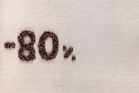 Roasted coffee beans shaping 80% off writing on creamy linen background, aligned middle left