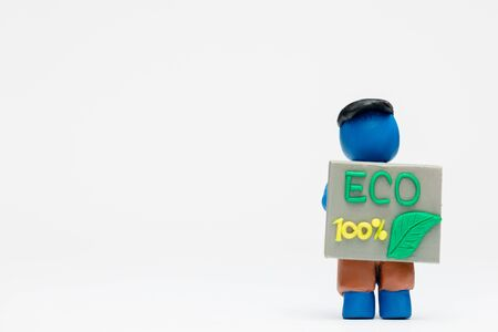A man made from blue plasticine holding a sign on which is written 100% eco on white background , aligned to the right.