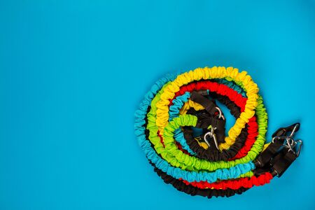 Many gym battle ropes on blue background, shot from above. 版權商用圖片