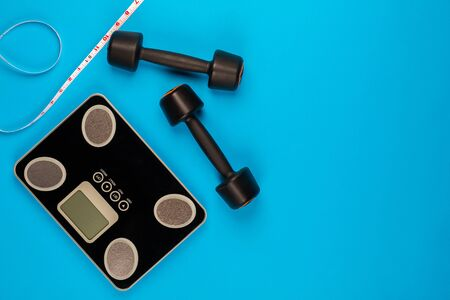 Gym equipment on blue background, shot from above. 版權商用圖片