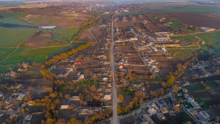 A shot of the central road of a beautiful village, aerial view.