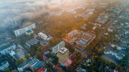 A beautiful shot of a city in the morning at sunrise in the fog.